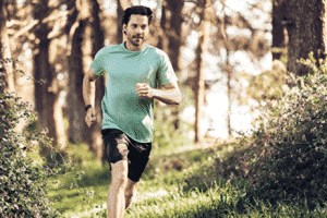 This is a man running while he uses the Fitbit Charge 3.