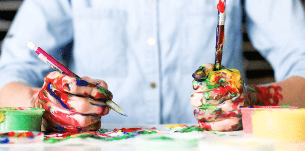 A child painting after following the Mastering Thinking Skills Bundle Ft. Timothy Kenny