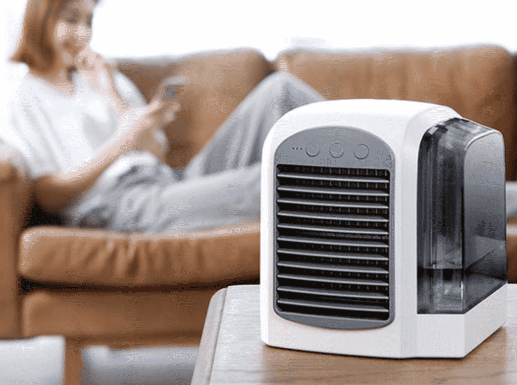 Kinkoo Mini Portable Air Conditioner with a lady in the background