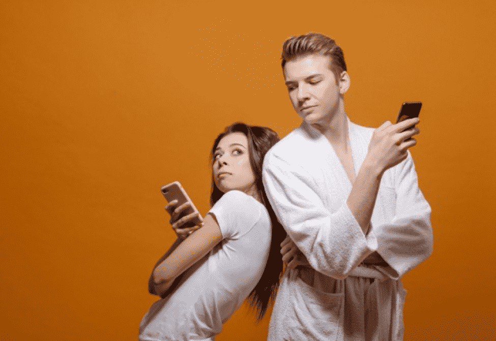 man-woman-with-phones-hands-yellow-man-spying-someone-else-s-phone_156359-1213.jpg