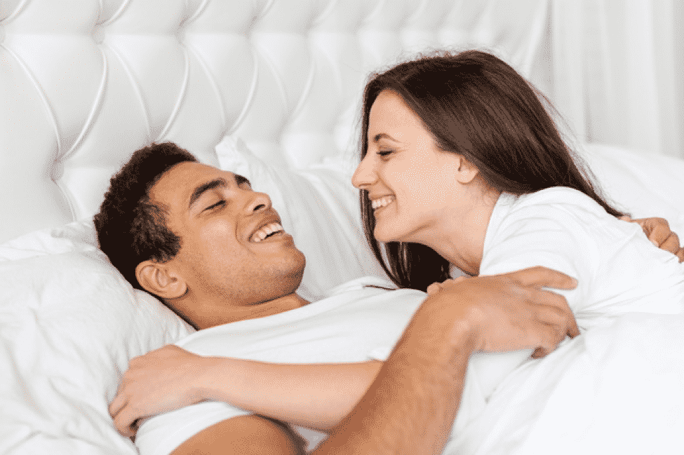 medium-shot-happy-couple-bed-together_23-2148334438.jpg