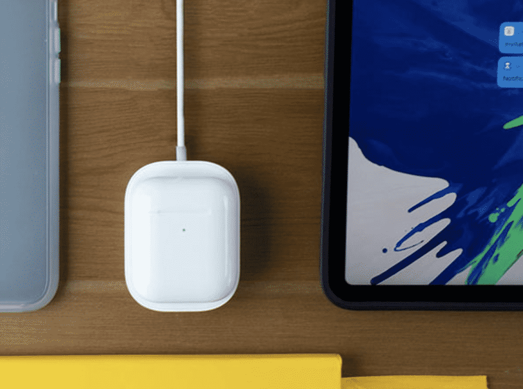 Wireless charging Pad with the AirPods by Apple
