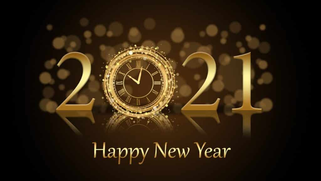 A clock with a happy new year 2021 image