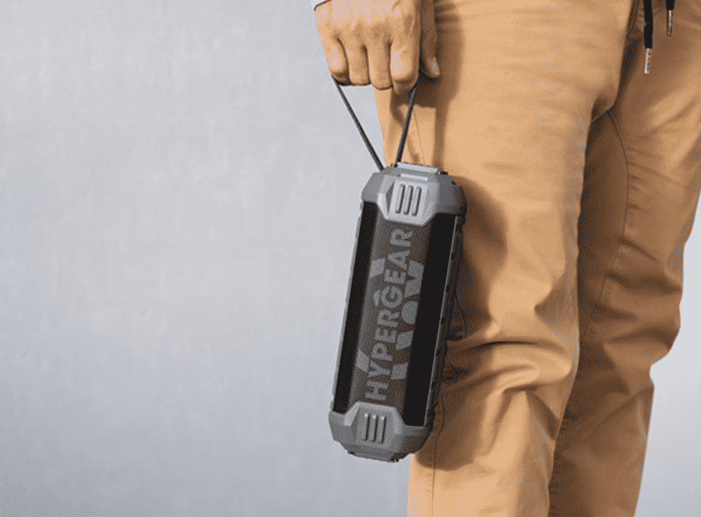 HyperGear Quake Wireless Speaker with Built-in Power Bank with a man holding it